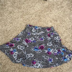 Torrid skater style skirt with a flower design